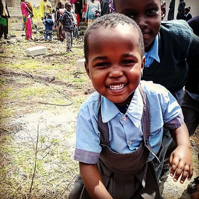 Smiling child for colunteer work